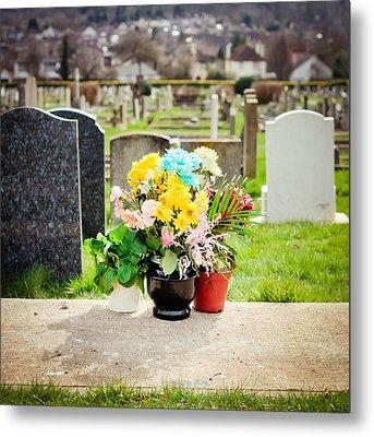 Cemetery Flowers Metal Print by Tom Gowanlock
