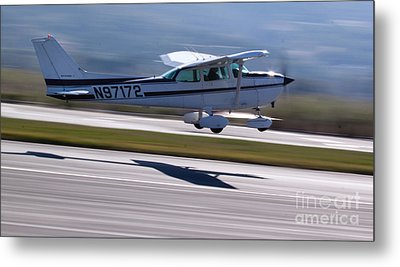 Cessna Takeoff Metal Print by John Daly