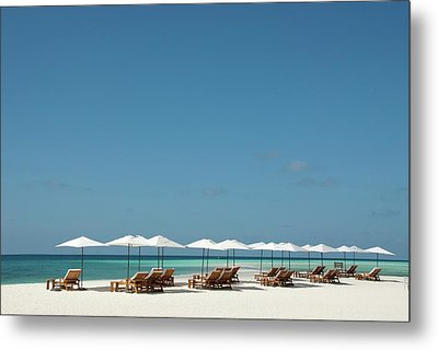 Chairs And Umbrellas On The Beach Metal Print by Scubazoo