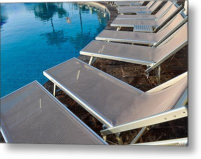 Chairs Around Hotel Pool Metal Print by Brandon Bourdages