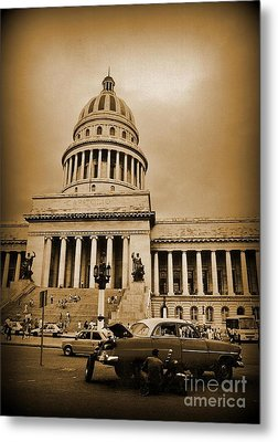 Changing A Tire In Front Of The Capitol Building In Havana Metal Print by John Malone