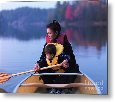 Child Learning To Paddle Canoe Metal Print by Oleksiy Maksymenko