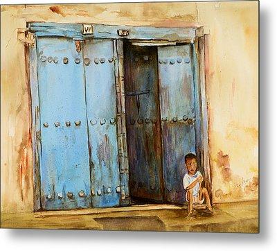 Child Sitting In Old Zanzibar Doorway Metal Print