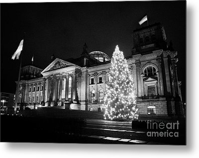 christmas tree and german flag flying fluttering on flagpole outside reichstag building Berlin Germany Metal Print by Joe Fox