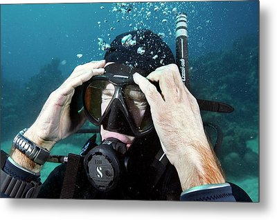 Clearing Water-filled Diving Mask Metal Print by Louise Murray