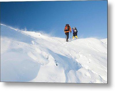 Climbers Being Blasted By Spindrift Metal Print by Ashley Cooper