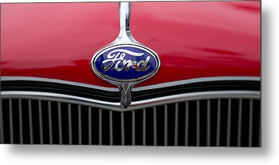 Close-up Of The Logo Of Fords Car Metal Print by Panoramic Images