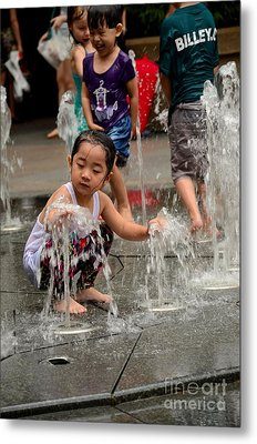 Clothed Children Play At Water Fountain Metal Print by Imran Ahmed