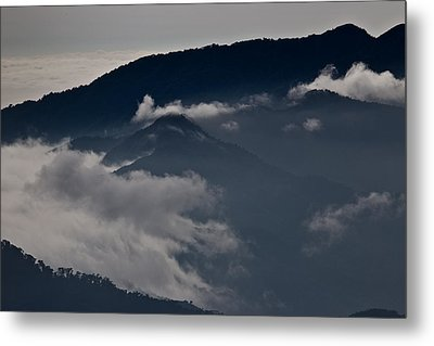 Clouds Over The Mounatins Metal Print by Brian Magnier