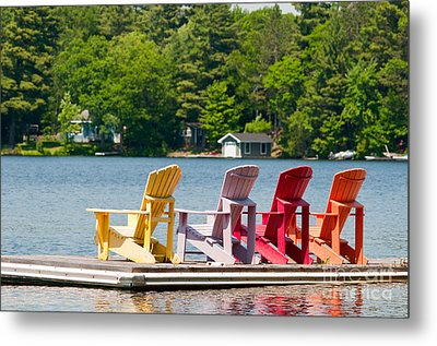 Metal Print featuring the photograph Colorful Chairs by Les Palenik