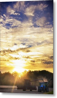 Combine At Sunset Metal Print by Michael Huddleston