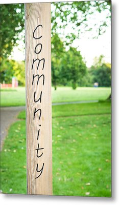 Community Sign Metal Print by Tom Gowanlock