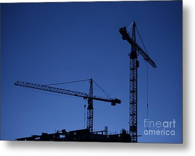 Construction Cranes At Dusk Metal Print by Antony McAulay