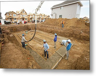 Construction Workers And Rows Of Houses Metal Print by Ashley Cooper