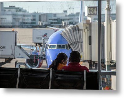 Couple Waiting At An Airport Metal Print by Jim West