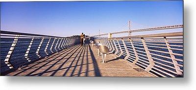 Couple Walking On A Pier, Bay Bridge Metal Print