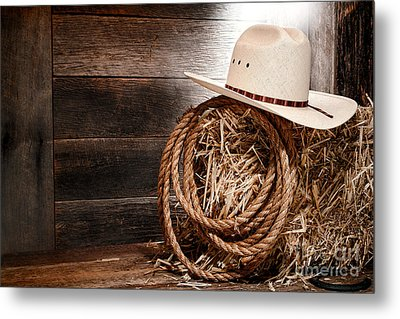Cowboy Hat On Hay Bale Metal Print by Olivier Le Queinec