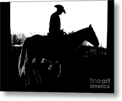 Metal Print featuring the photograph Cowboy Rides Home In Silhouette by Lincoln Rogers