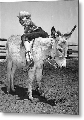 Cowgirl Backwards On A Donkey Metal Print by Underwood Archives