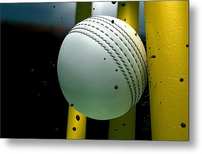Cricket Ball Striking Wickets With Particles At Night Metal Print by Allan Swart