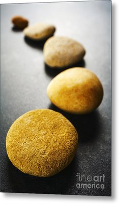 Curving Line Of Brown Pebbles On Dark Background Metal Print