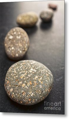 Curving Line Of Speckled Grey Pebbles On Dark Background Metal Print by Colin and Linda McKie