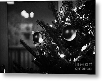 decorated christmas tree looking out of window to snow covered scene in small rural village of Forge Metal Print by Joe Fox