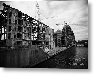 demolition of the Palast der Republik on the bank of the river Spree with the Berliner Dom in the background Berlin Germany Metal Print by Joe Fox