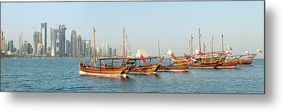 Dhows On Parade In Doha Metal Print by Paul Cowan