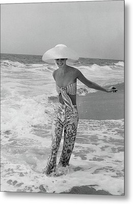 Diana Ewing Playing At A Beach Metal Print by John Shannon
