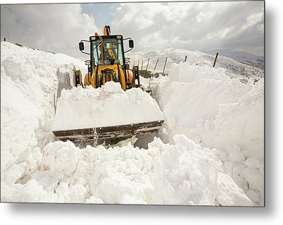 Digger Clearing Snow Drifts Metal Print by Ashley Cooper