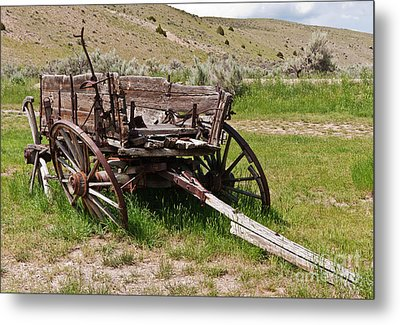 Dilapidated Wagon With Leaning Wheels Metal Print by Sue Smith