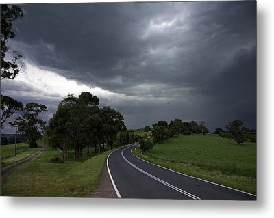 Driving Into A Storm Metal Print by Lee Stickels