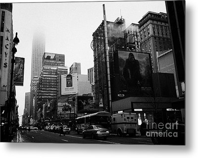 empire state building shrouded in mist from west 34th Street and 7th Avenue new york city usa Metal Print by Joe Fox