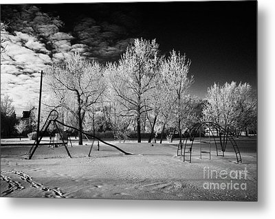 empty childrens playground with hoar frost covered trees on street in small rural village of Forget  Metal Print by Joe Fox