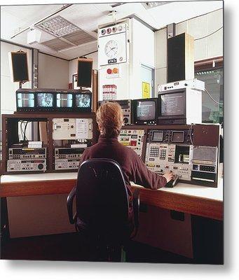 Engineer Siting In Front Of Control Panel Metal Print by Dorling Kindersley/uig