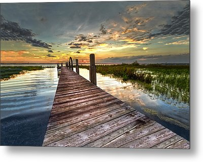 Evening Dock Metal Print by Debra and Dave Vanderlaan