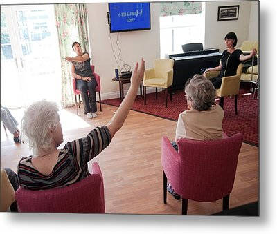 Exercise Class At A Care Home Metal Print by John Cole