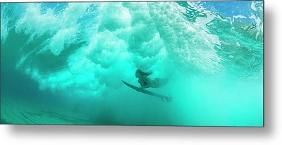 Female Surfer Pushes Under A Wave While Metal Print by Panoramic Images