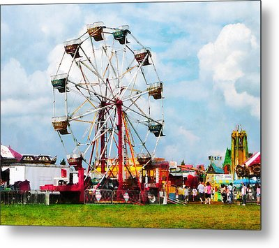 Ferris Wheel Against Blue Sky Metal Print by Susan Savad