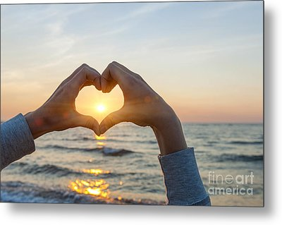 Fingers Heart Framing Ocean Sunset Metal Print by Elena Elisseeva