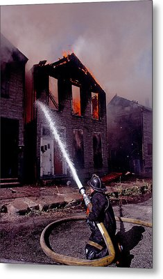 Firefighter During A Rescue Operation Metal Print