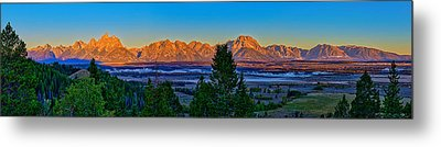 First Light On The Tetons Metal Print by Greg Norrell
