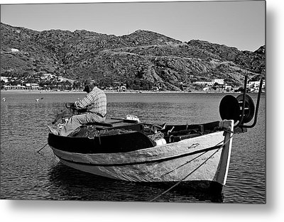 Fisherman Cleaning His Nets Metal Print by George Atsametakis