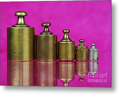 Five Copper Weights In A Row Metal Print