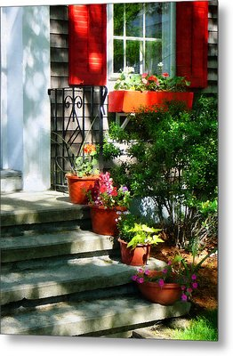 Flower Pots And Red Shutters Metal Print by Susan Savad