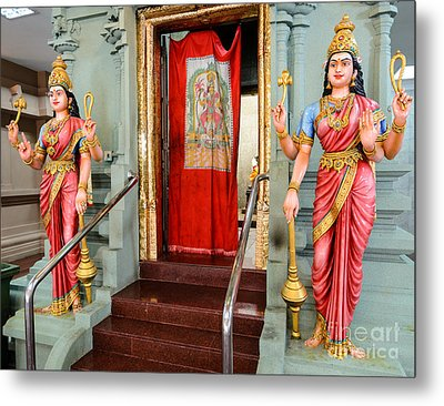 Four-armed Deities Guard The Inner Sanctum Of A Hindu Temple Metal Print by David Hill