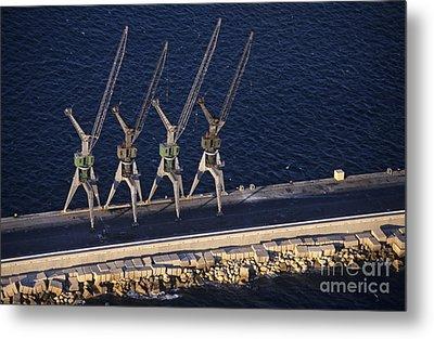 Four Harbour Cranes On Dike Metal Print by Sami Sarkis