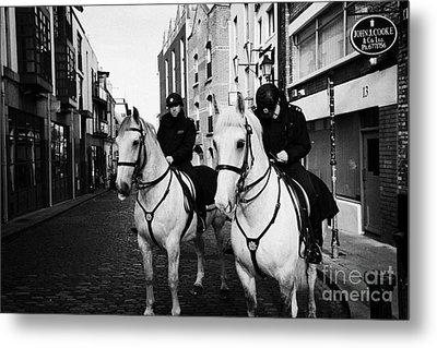 Garda Siochana Mounted Police On Horseback Taking Notes In Temple Bar Dublin Republic Of Ireland Metal Print by Joe Fox