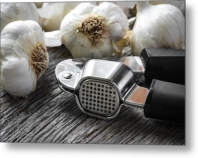Garlic Press And Garlic Bulb Close Up On Rustic Wood Background Metal Print by Brandon Bourdages